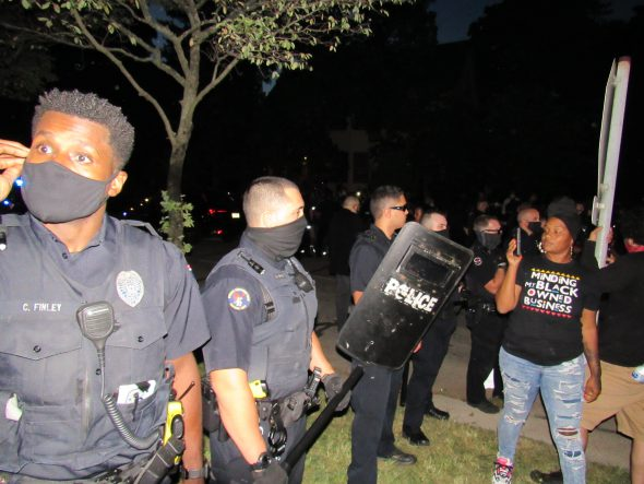 Wauwatosa officers confront protesters in the days after the incident at Mensah's house. Photo by Isiah Holmes/Wisconsin Examiner.