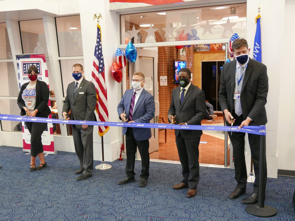 Ribbon cutting for USO Lounge and Mitchell Gallery of Flight. Photo by Grahm Kilmer.