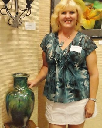 Lorrie Wickman, 56, of Porterfield, Wis., says selling her clay, glass and wire pieces was her main source of income. That dried up as the pandemic canceled art shows. She also lost part-time work helping elderly and disabled Wisconsinites hire in-home care staff. Wickman and her 36-year-old son — who also has a disability — live with Wickman's boyfriend, whose auto mechanic job has kept the household afloat while she waited on unemployment aid. She is seen here in 2011. Photo courtesy of Lorrie Wickman.