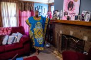Wyconda Clayton is seen with pictures of family members inside her home in Milwaukee on July 17, 2020. She fell behind on rent while caring for her elderly mother, prompting her landlords to file for eviction. She received last-minute rental assistance through the state, but the landlords refused to accept it. She hopes to eventually remove the eviction from her public record under an agreement to move within 60 days. Photo by Will Cioci/Wisconsin Watch.