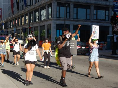 Suburban Protesters March From Tosa to DNC