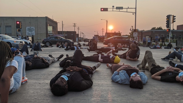Protesters lay down during march on Tuesday night, Aug. 25, 2020, in Kenosha. Angela Major/WPR