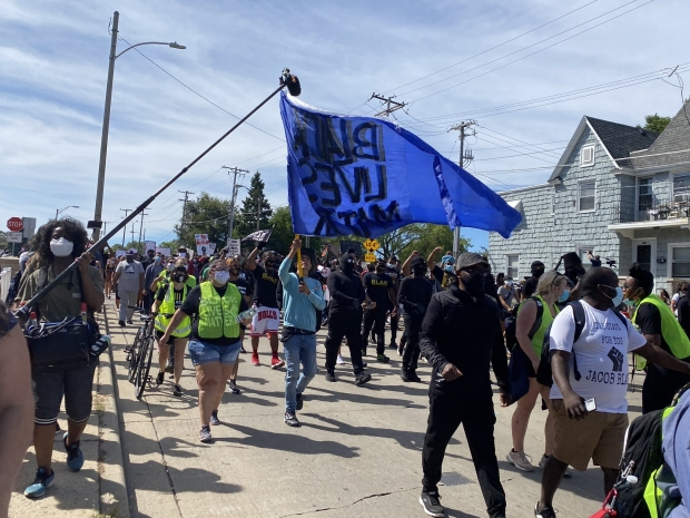 Over 1,000 people gathered in Kenosha for a #JusticeForJacobBlake march and rally on Aug. 29, 2020, led by Jacob Blake's family. Corrine Hess/WPR