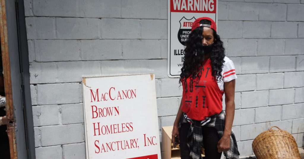 Diane Green, a 54-year-old resident of Milwaukee's Northwest Side, stands outside the MacCanon Brown Homeless Sanctuary, 2461 W. Center St., as she waits for a fan. The agency distributed hundreds of fans to residents in the 53206 ZIP code this summer. Photo courtesy of NNS.