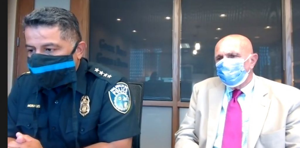 Police Chief Alfonso Morales and Attorney Frank Gimbel speak to the Milwaukee Press Club.