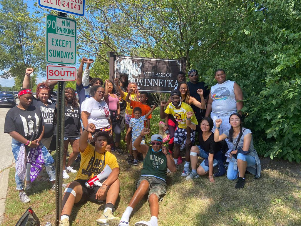 Frank Nitty (back row, hat, left of W in Winnetka) and Tory Lowe (back row, right, sunglasses) pose with fellow marchers in Winnetka, Illinois on march to Washington D.C. Photo courtesy Frank Nitty.