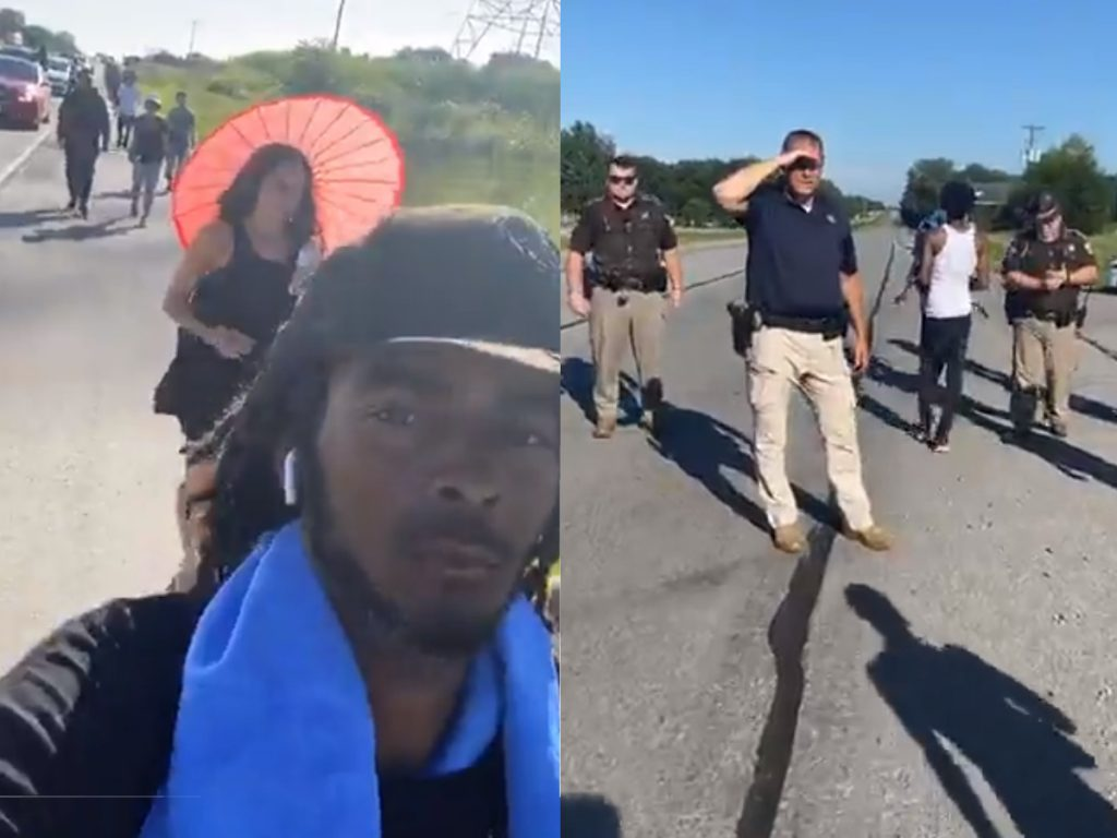 Frank Nitty marching in Indiana, with Indiana State Police blocking the group's forward progress. Images from Nitty's Facebook live video.