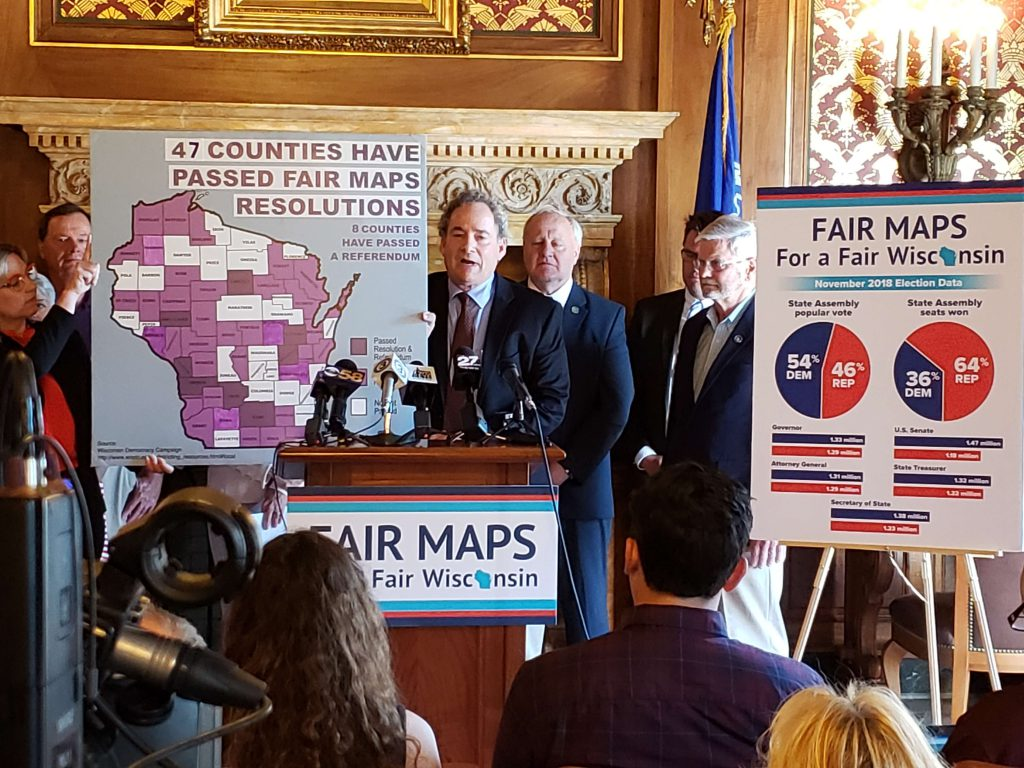 A press conference in July 2019 issuing a call to action to demand Fair Maps for Wisconsin. Photo from Wisconsin Examiner.