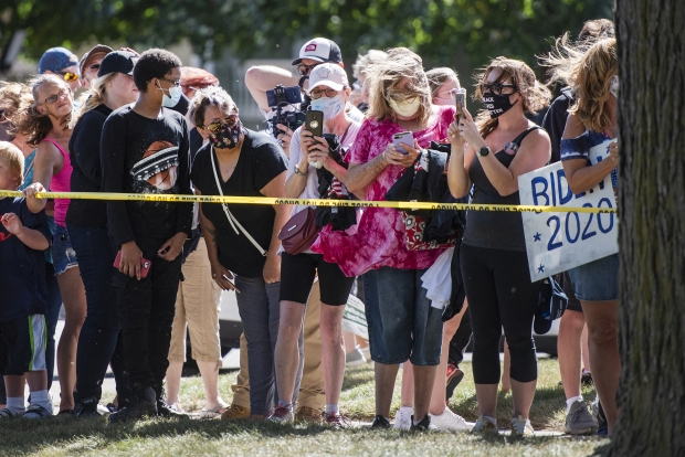 A crowd gathers to try to catch a glimpse of Democratic candidate Joe Biden's motorcade as he leaves Thursday, Sept. 3, 2020, in Kenosha. Angela Major/WPR