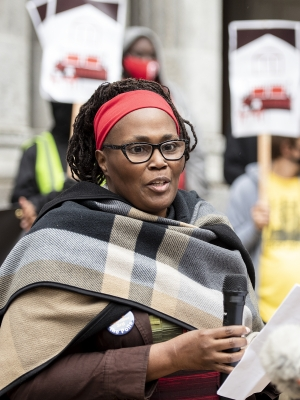 """Nicole Gallman speaks at the event Thursday, Sep. 10, 2020, in Milwaukee. Standing in front of Sen. Ron Johnson's Milwaukee office, she said """"elected leaders are failing to step up."""" Angela Major/WPR"""