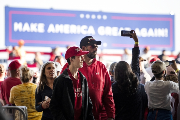 People walk into the Central Wisconsin Airport prior to a rally for President Donald Trump on Thursday, Sept. 17, 2020, in Mosinee, Wis. Angela Major/WPR