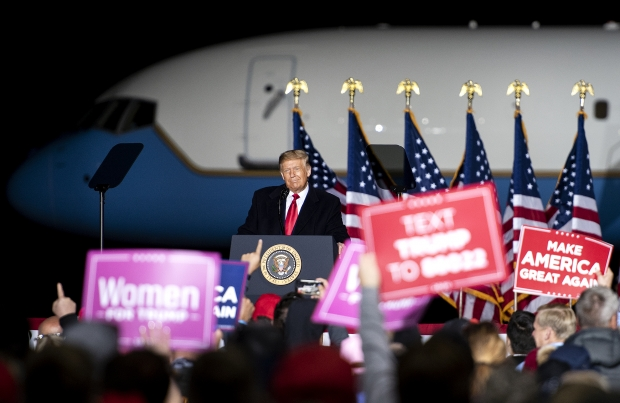 Supporters hold up signs Pres. Donald Trump speaks Thursday, Sept. 17, 2020, in Mosinee, Wis. Angela Major/WPR