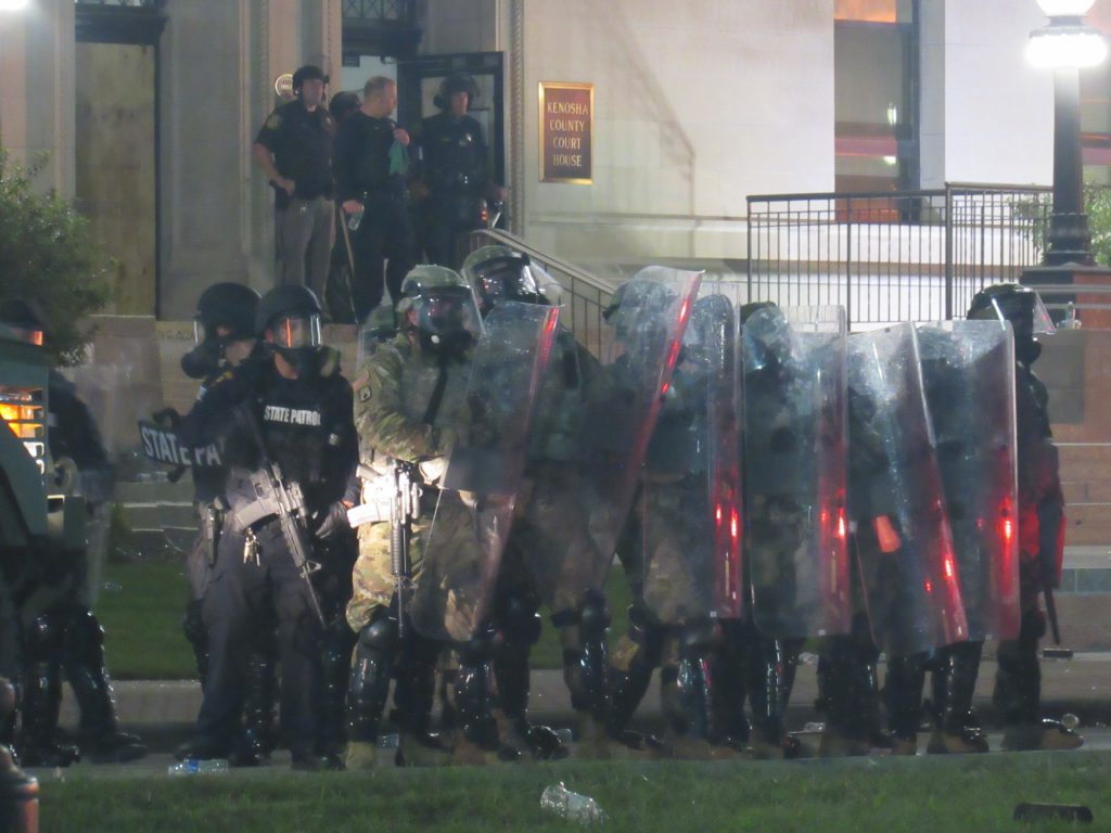 Kenosha law enforcement form up with riot shields, long rifles, and armored vehicles. Photo by Isiah Holmes/Wisconsin Examiner.