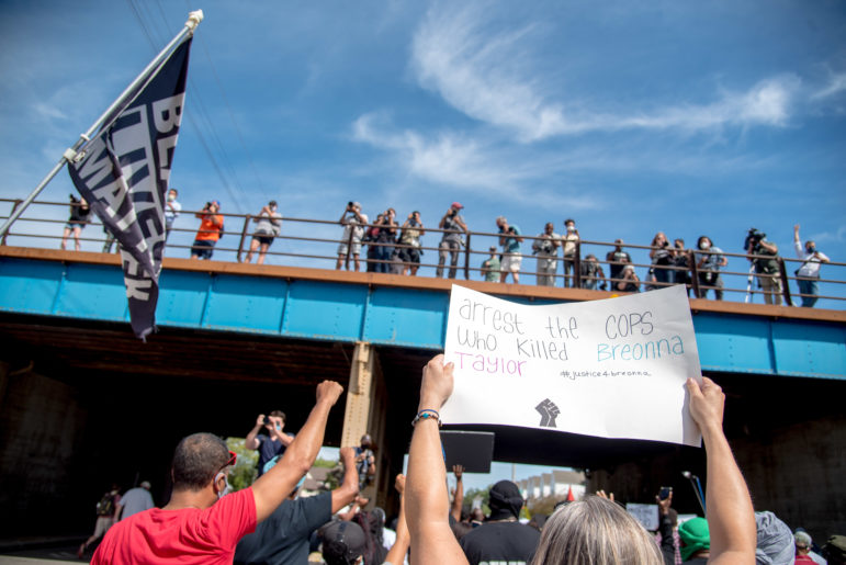 Photographers and press look down from a railroad bridge at a march in Kenosha, Wis. on Aug. 29, 2020, demanding justice for Jacob Blake, a Black man shot in the back seven times by a Kenosha police officer. Will Cioci / Wisconsin Watch