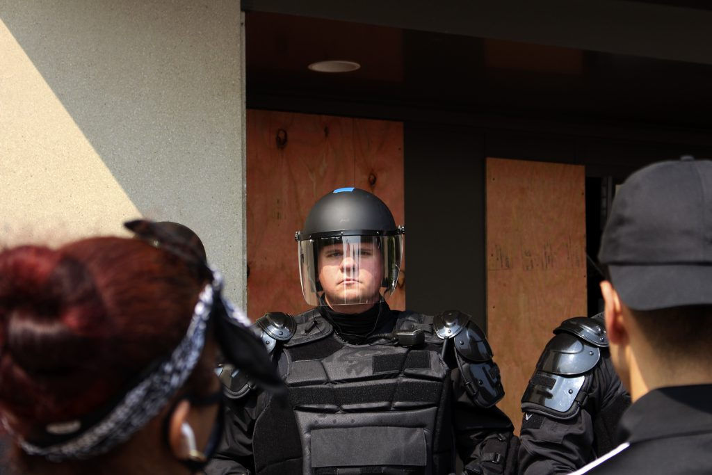 Riot officers pepper sprayed protesters immediately after reaching the door. Photo by Henry Redman/Wisconsin Examiner.