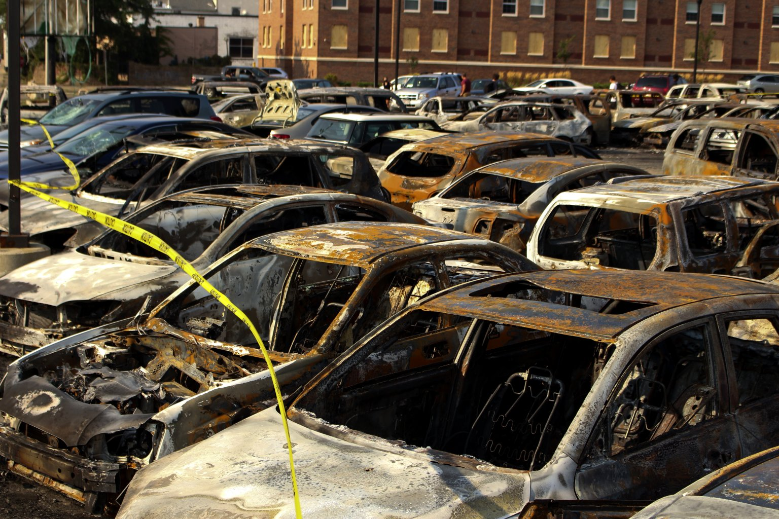 Burned out vehicles in Kenosha. Photo by Henry Redman/Wisconsin Examiner.