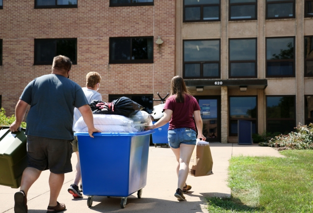 Student moves in UW-Eau Claire dormitory. Photo by Rich Kremer/WPR.