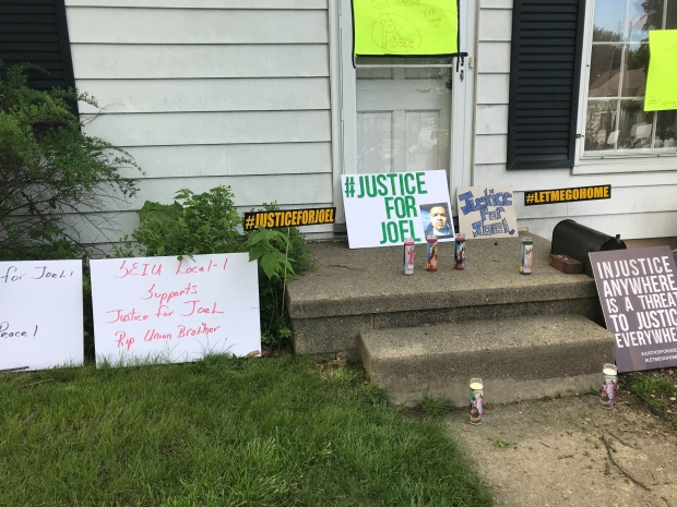 Demonstrators left signs calling for justice for Joel Acevedo outside Milwaukee Police officer Michael Mattioli's house in a protest on May 29, 2020. Madeline Fox/WPR