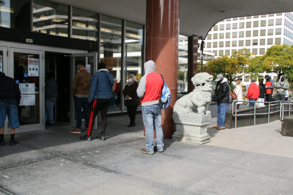 Voters wait in line to vote early at the Zeidler Municipal Building. Photo by Jeramey Jannene.