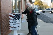 Mayor Tom Barrett and his wife Kris Barrett place their ballots in a drop box. Photo by Jeramey Jannene.