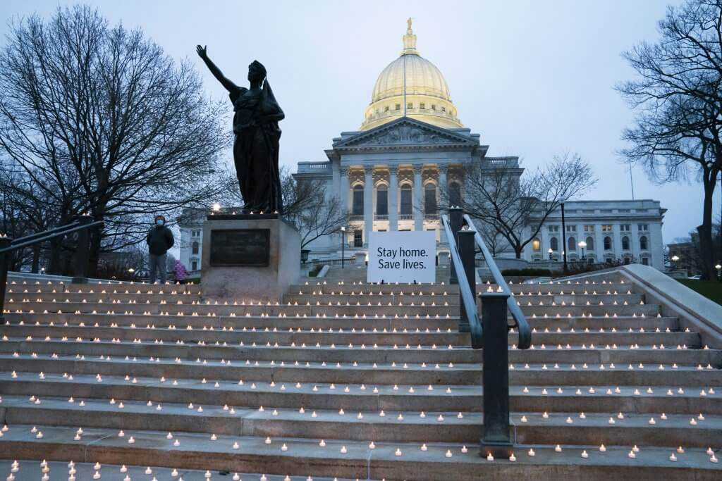 On April 23, 2020, nurses gathered at the state Capitol building in Madison to remember 7,358 Wisconsin residents who had been diagnosed with COVID-19, including 278 who had died. On Thursday, Oct 8, there were 3,132 newly confirmed cases and a total of 141,830 in the state, with 1,424 deaths. Photo by Luther Wu/Wisconsin Examiner.