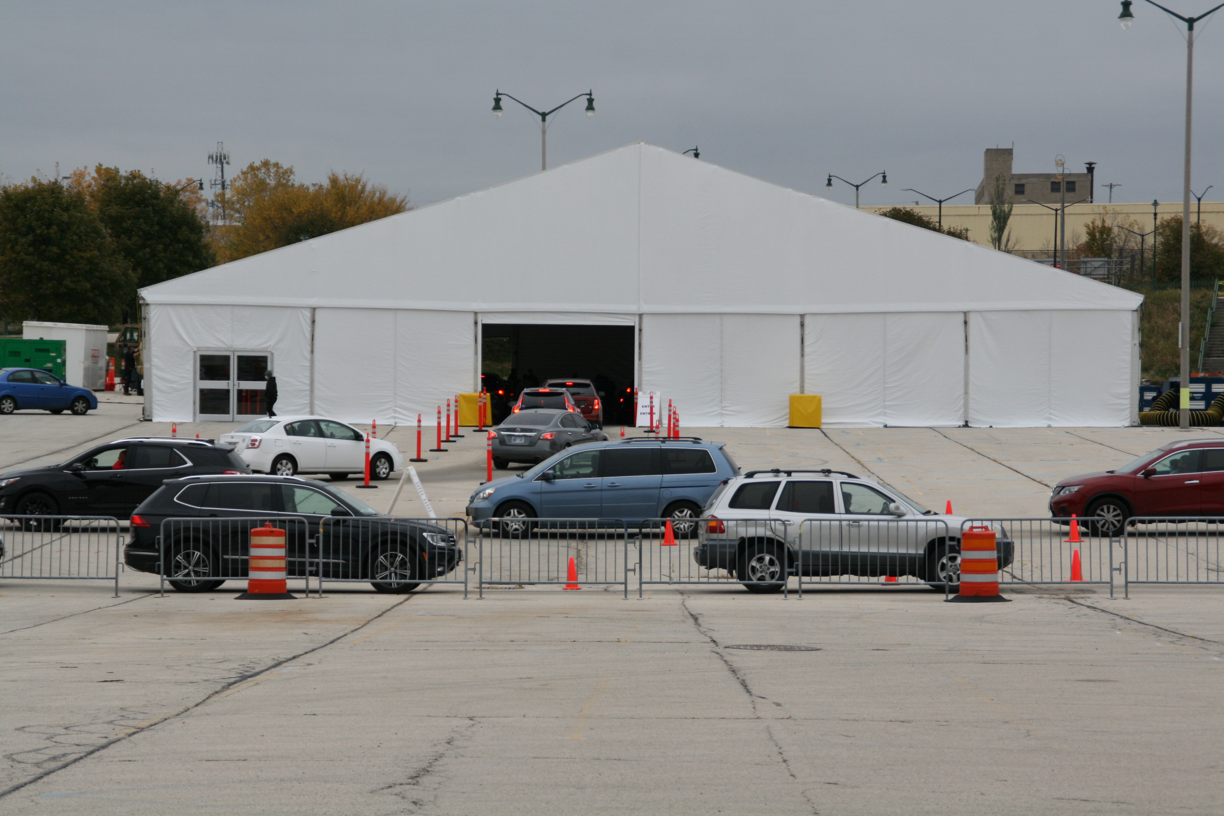 People wait in vehicles to be tested for COVID-19 at Miller Park. Photo by Jeramey Jannene.