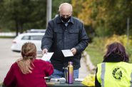 Ken Disch stops by the Democracy in the Park event Saturday, Oct. 3, 2020, at Garner Park in Madison. Angela Major/WPR