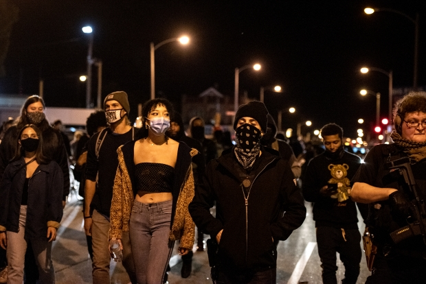 Protesters cross into Wauwatosa after marching from Milwaukee on Wednesday, Oct. 7, 2020. Angela Major/WPR