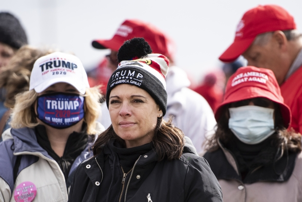 Michele Heckermann traveled from Illinois to attend a rally for President Donald Trump on Saturday, Oct. 17, 2020, in Janesville. Despite a rising number of positive cases of COVID-19 in Wisconsin, she said the pandemic is not on her mind. Angela Major/WPR