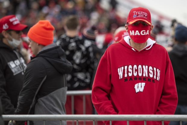 """Marcos Gallegos of Waukesha attends a rally for President Donald Trump on Saturday, Oct. 17, 2020, at the Southern Wisconsin Regional Airport in Janesville. He said he doesn't blame Donald Trump for the coronavirus pandemic. """"He's not losing my support,"""" he said. Angela Major/WPR"""