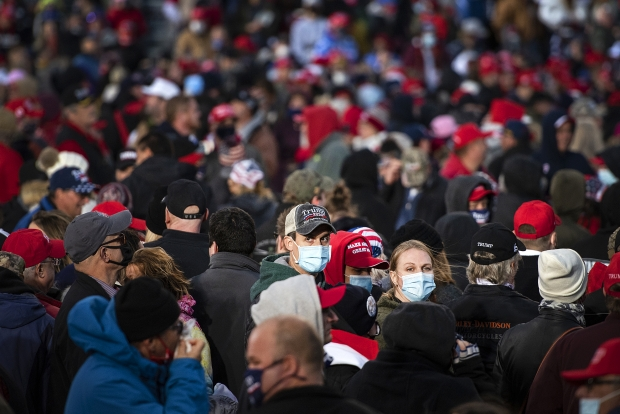 A supporter of President Donald Trump wears a mask in a crowd of thousands Saturday, Oct. 17, 2020, at the Southern Wisconsin Regional Airport in Janesville. Angela Major/WPR