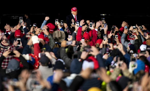 President Donald Trump approaches a sea of supporters Saturday, Oct. 17, 2020, at the Southern Wisconsin Regional Airport in Janesville. Angela Major/WPR