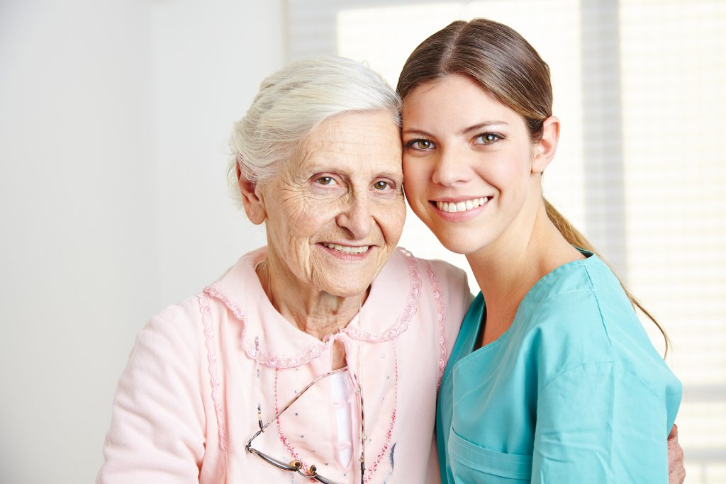 Caregiver with a senior woman in a nursing home. (Public Domain)