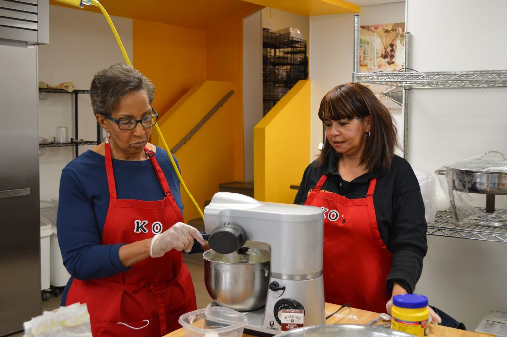 Olivia Muhammad (right) says her sister Kaye Muhammad talked her into creating their business, K.O.'s Delicious Desserts. Photo by Ana Martinez-Ortiz/NNS.