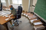 Election official Lenny Black alphabetizes returned absentee ballots in the City-County Building in Madison, Wis., on Aug. 5, 2020. Will Cioci / Wisconsin Watch