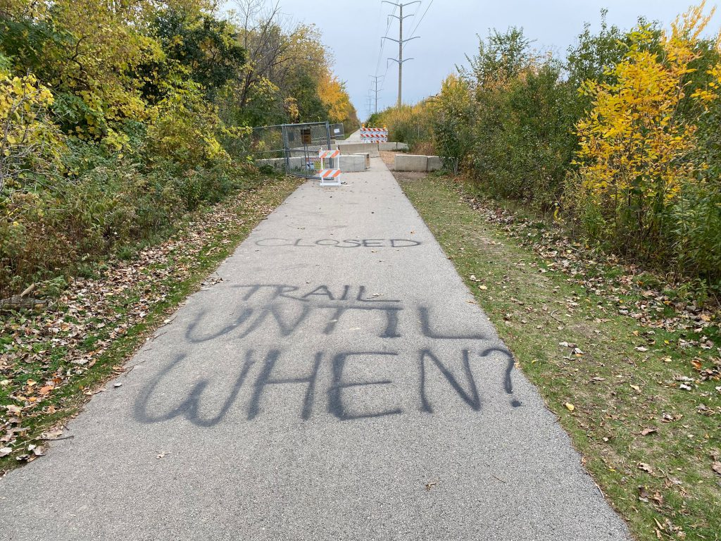 A sinkhole has forced Milwaukee County to close a part of the Oak Leaf Trail. Photo by Graham Kilmer.