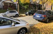 Vehicles parked on a Milwaukee street. Photo by Jeramey Jannene.
