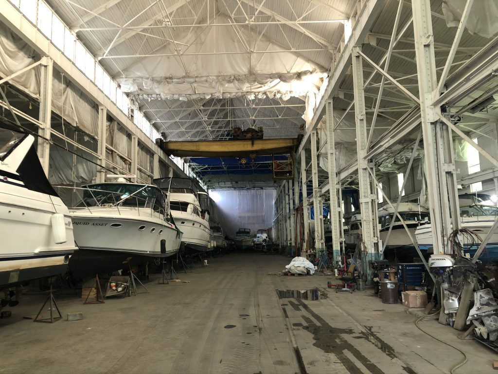 The eastern manufacturing building at the Filer & Stowell complex is now used for boat storage by Southwind Marine. Photo by Jeramey Jannene.
