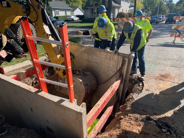 Crews replace a lead service line on Emilie Street in Green Bay, Wis, on Tuesday, Oct. 6, 2020. It was the last one in the city, officials said. Megan Hart/WPR