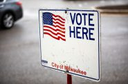 This sign directs voters to an early voting location at Midtown Shopping Center in Milwaukee on Oct. 28, 2018. Emily Hamer/Wisconsin Watch