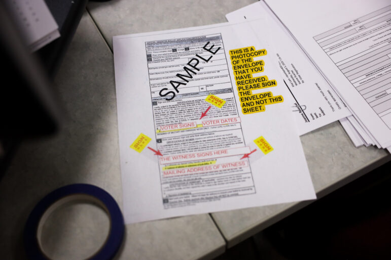 Joanne Ruechel, town clerk of Rib Mountain, Wis., sent out 1,348 absentee ballots ahead of the Aug. 11, 2020 partisan primary, and included a sample ballot with instructions on how to fill it out, to try to prevent the errors she saw during the April 7, 2020 primary. She made these instructions by hand, as they were not provided by the county or state for the election. Photographed Aug. 11, 2020. Coburn Dukehart / Wisconsin Watch