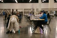 Observers watch workers at Milwaukee County's presidential recount. Photo by Jeramey Jannene.