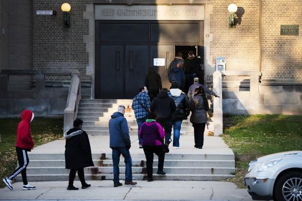 Voters enter Washington High School as polls open at 7:00 a.m. on Wednesday, Nov. 3, 2020, in Milwaukee. Angela Major/WPR