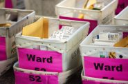 Absentee ballots are stored in box Tuesday, Nov. 3, 2020, at Milwaukee's Central Count facility. Angela Major/WPR