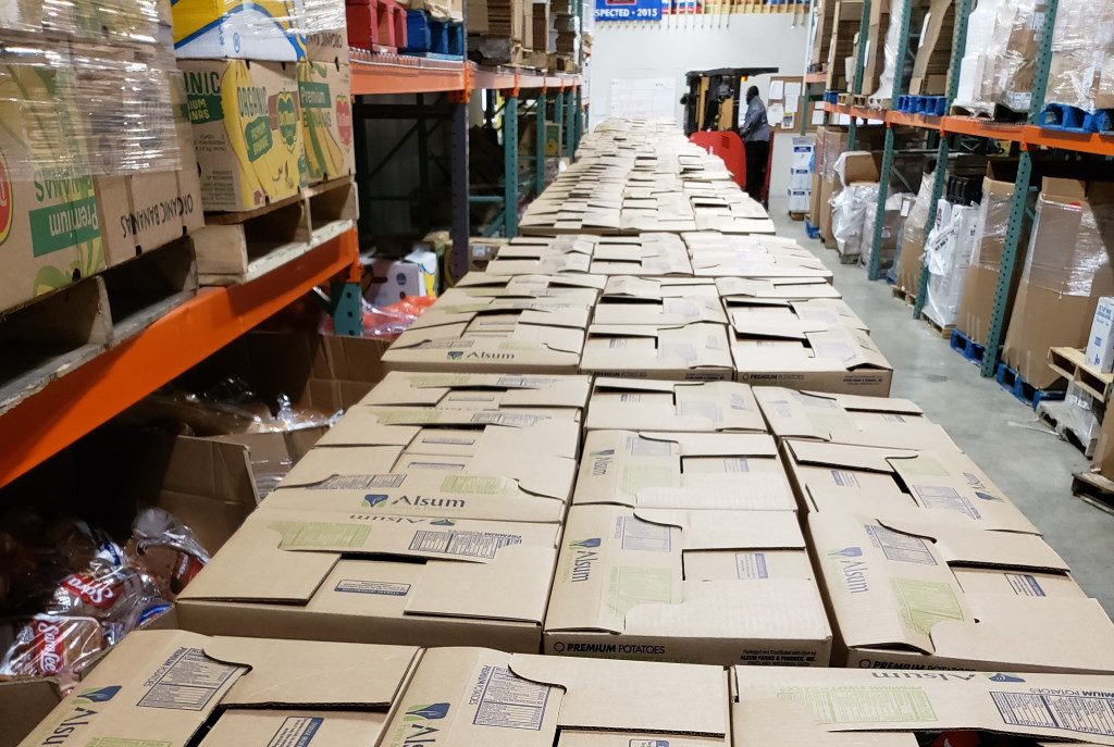 Pre-packed boxes of food wait to be given to families in need. Photo from Second Harvest/Wisconsin Examiner.