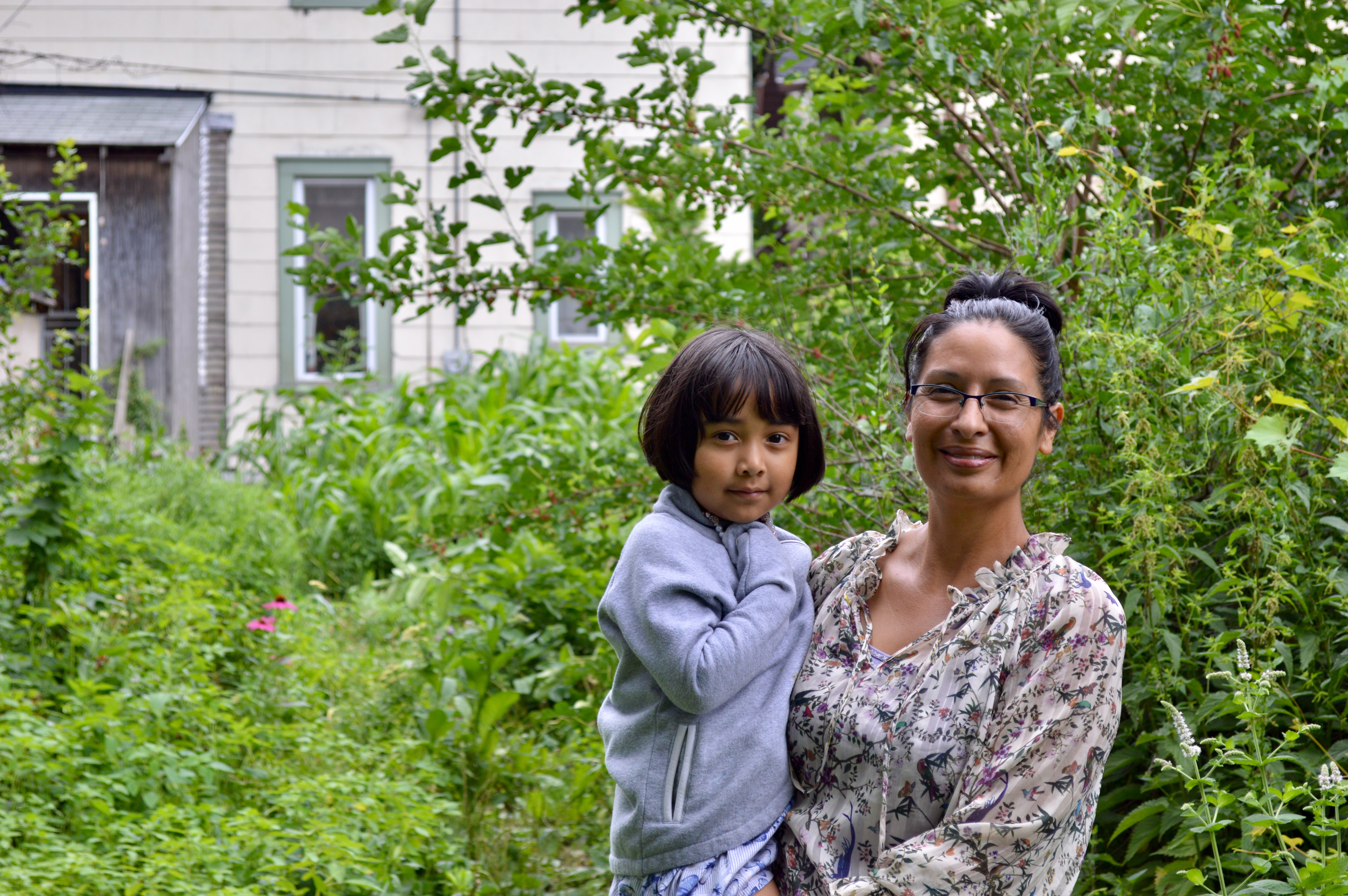 Like her mother before her, Angela Kingsawan has her daughters, including the youngest Elena (pictured here), work alongside her in the garden. Photo by Ana Martinez-Ortiz/NNS.