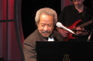 Allen Toussaint at the piano on stage at the Roosevelt Hotel, New Orleans October 24th, 2009. Photo by Marie Carianna, CC BY-SA 2.0 , via Wikimedia Commons