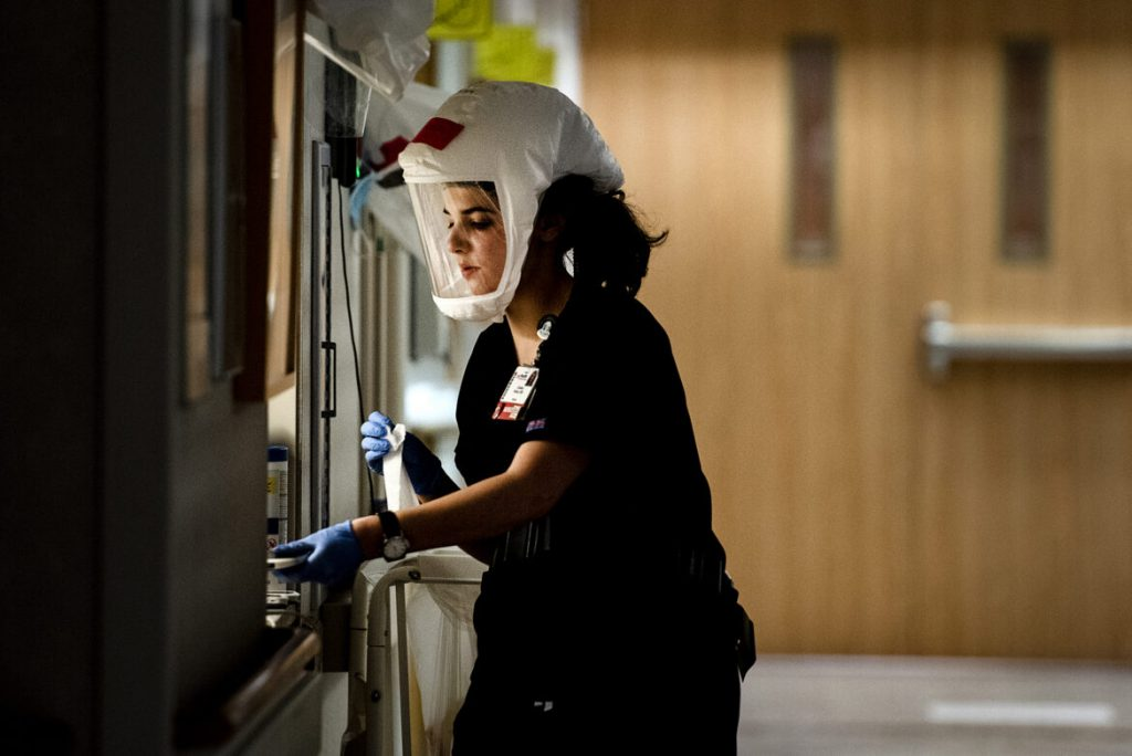 Christina Brahos, a registered nurse, uses wipes after caring for a patient with COVID-19 on Tuesday, Nov. 17, 2020, at University Hospital in Madison, Wis. Angela Major / WPR