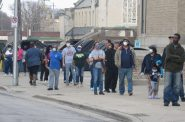 Voters wait in line to vote at Washington High School on April 7. Photo by Isiah Holmes/Wisconsin Examiner.