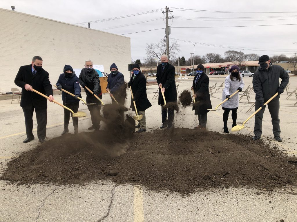 Mayors Shawn Reilly and Tom Barrett are flanked by city officials as they celebrate the Great Water Alliance groundbreaking. Photo by Jeramey Jannene.